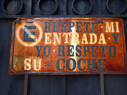 'No Parking' sign on a garage door in Coyacan, Mexico