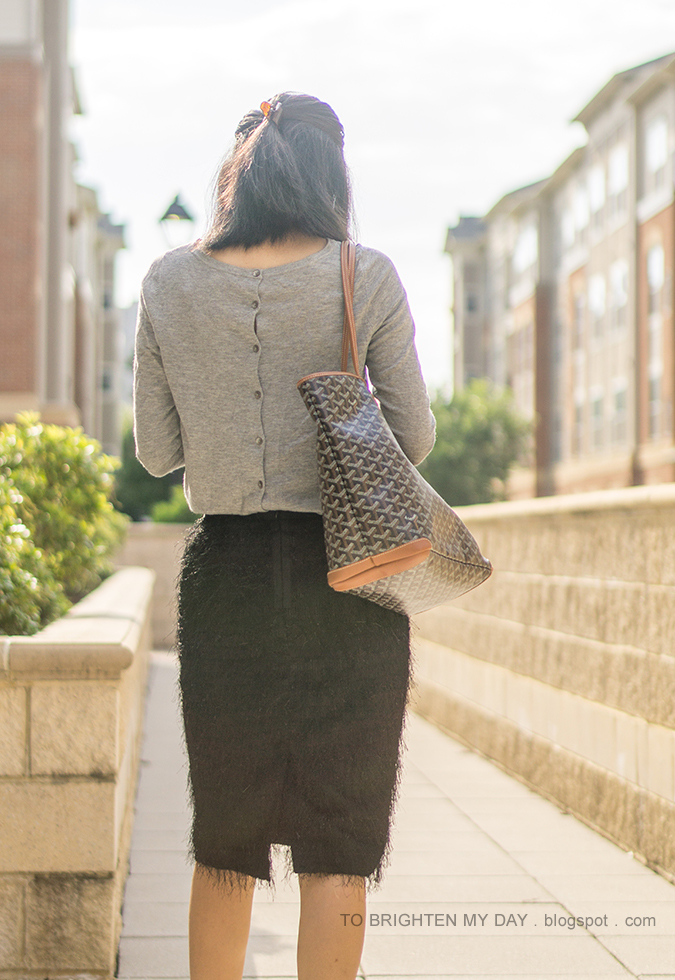 gray button back sweater, patterned tote, black fringe pencil skirt