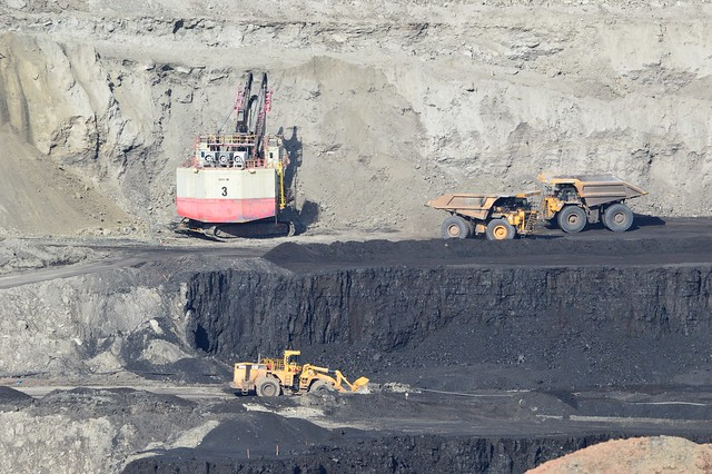 Rock is being removed on one level while coal is scooped up on another, Eagle Butte Mine