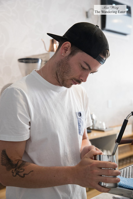 Co-owner Andrew Bassett steaming milk for cappuccino