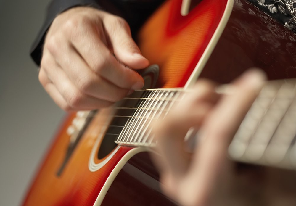 close-up photo of guitarist practicing