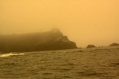 Smoke and ash from nearby fires turned the air orange at Point Bonita lighthouse.