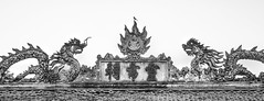 Dragon carvings on the rood of Den Voi Phuc Temple, Hanoi, Vietnam