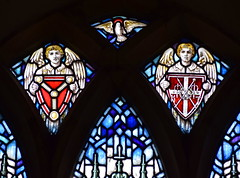 angels holding shields of the Holy Trinity and Instruments of Passion (Mary Lowndes, 1920)