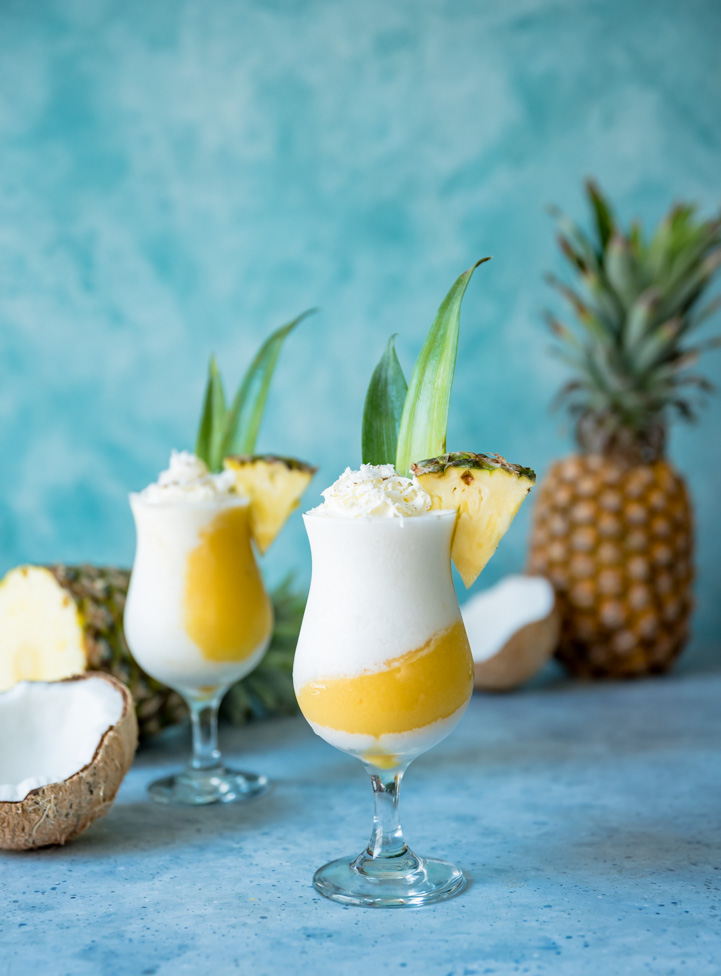 Golden Layered Piña Coladas www.pineappleandcoconut.com #KoloaRum #nationalpinacoladaday #fRumHawaii