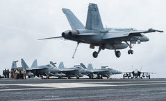 PHILIPPINE SEA (July 4, 2018)  An F/A-18E Super Hornet, assigned to Strike Fighter Squadron (VFA) 195, lands on the flight deck of the aircraft carrier USS Ronald Reagan (CVN 76). Ronald Reagan is the flagship of Carrier Strike Group 5, providing a combat-ready force that protects and defends the collective maritime interests of its allies and partners in the Indo-Pacific region. (U.S. Navy photo by Mass Communication Specialist 2nd Class Kenneth Abbate/Released)