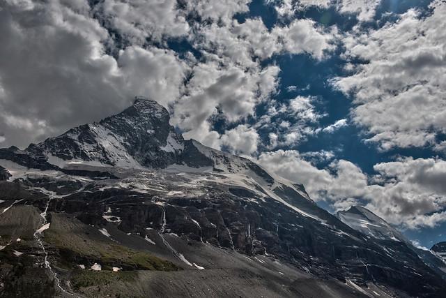 The Matterhorn, Cervin Cervino. (4,478 m alt. ) and the Dent d'Hèrens (4,171 m alt) at summer time. Canton of Valais, Switzerland.Izakigur no. 30.06.18, 16:28:06 No, 1061.