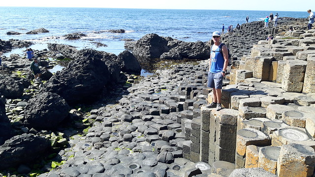 Terry standing on the hexagonal rock columns at Giant's Causeway, Northern Ireland.