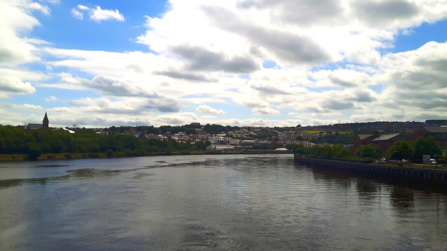 View across a river to the skyline of Derry-Londonderry, Northern Ireland.