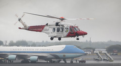 HM Coastguard passing Air Force One aircraft