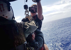 Sailors from Helicopter Sea Combat Squadron (HSC) 25 brings a rescued diver aboard their MH-60S Sea Hawk helicopter, July 26. (U.S. Navy/HM1 Alexander Nguyen)