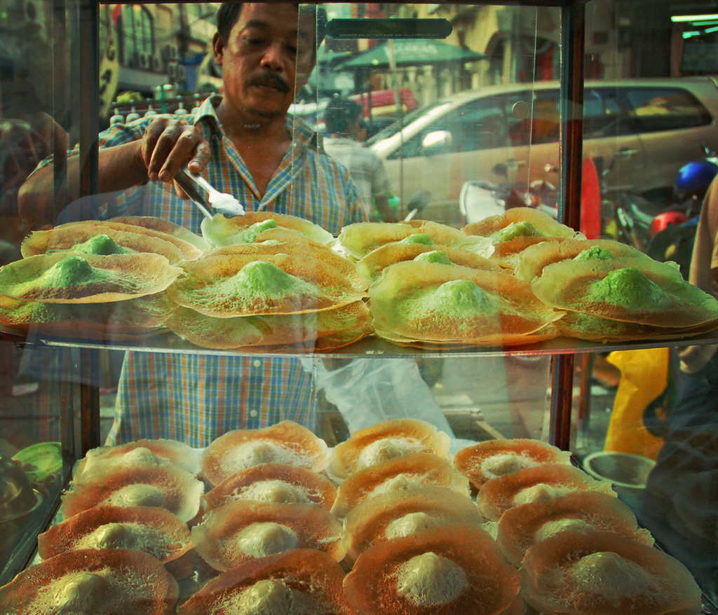 A street hawker selling Ape cakes image by Mo Riza, on Flickr CC