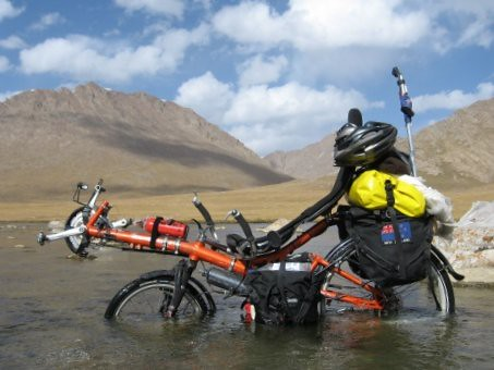 HPV Street Machine GTe crossing a river on Kerege-Tash Pass, Kyrgyzstan