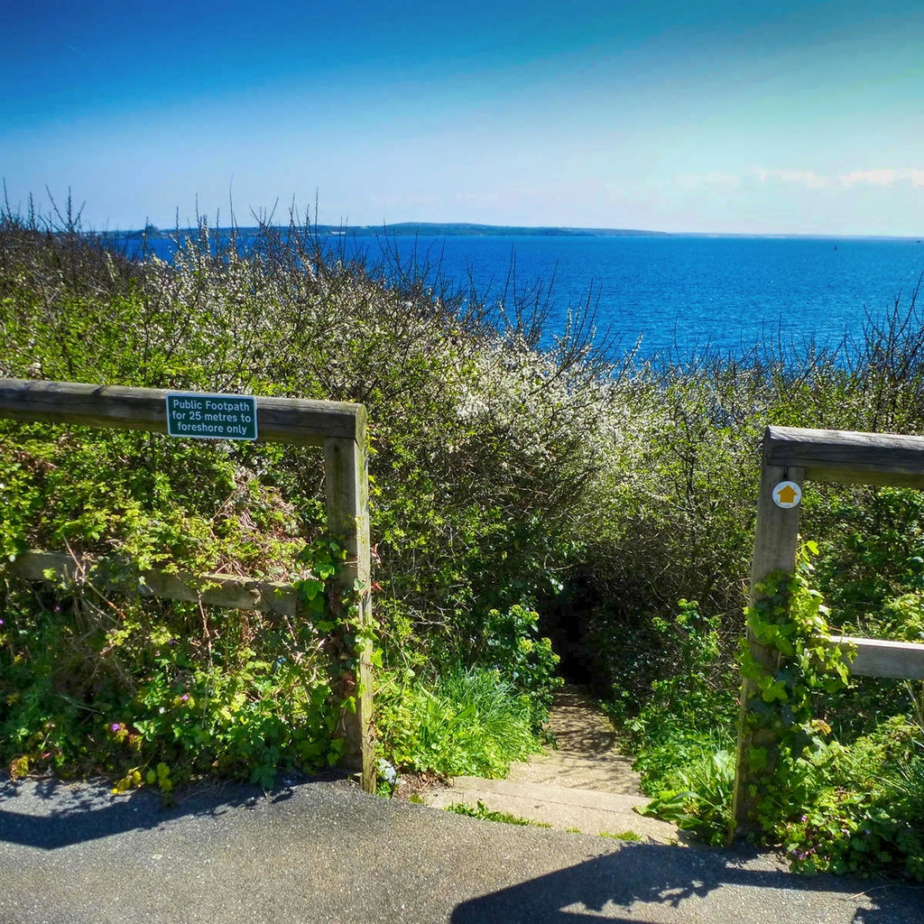 A public footpath down some steps to a Cornish beach. Credit Jane White