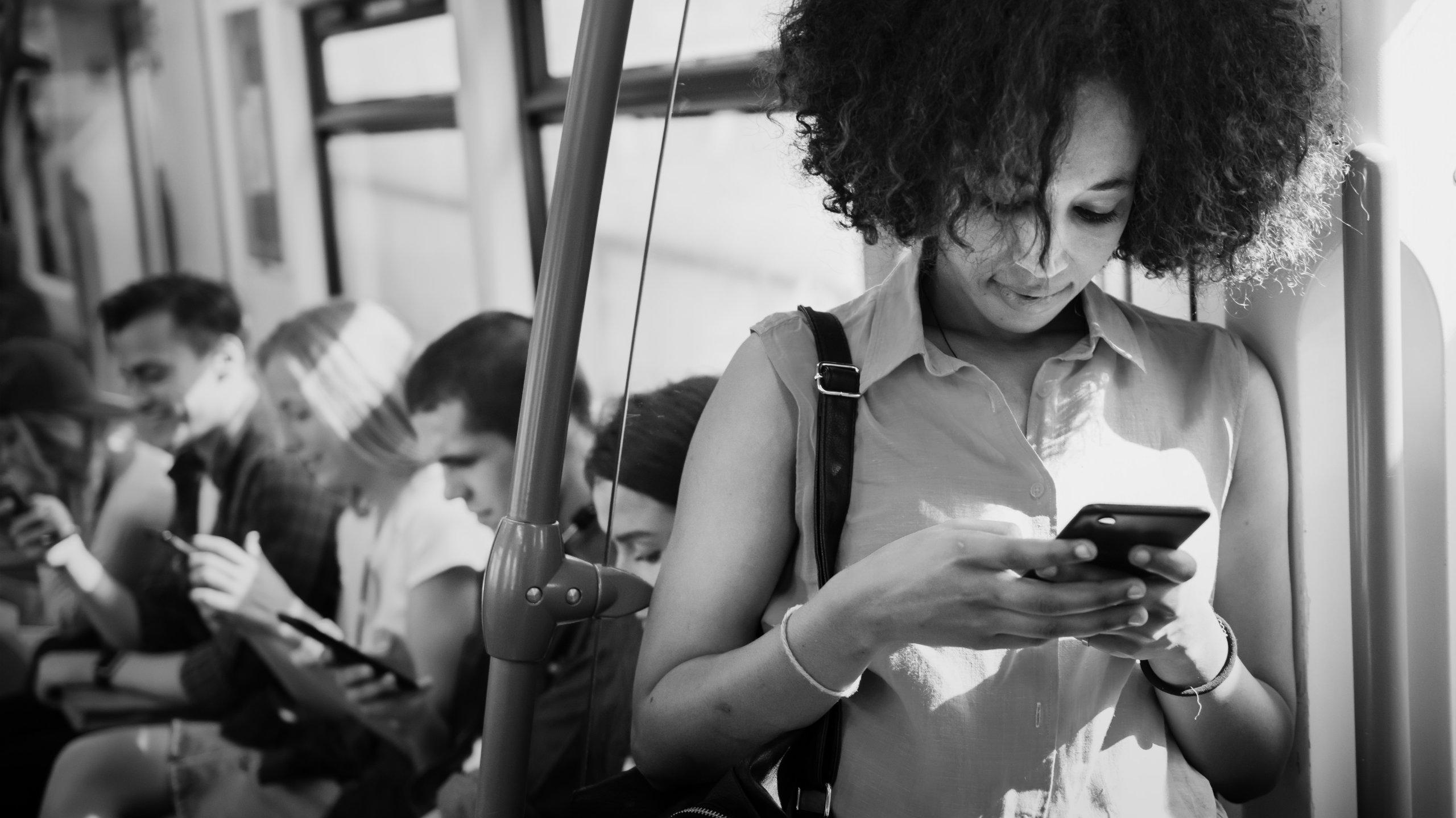 train passengers using smartphones