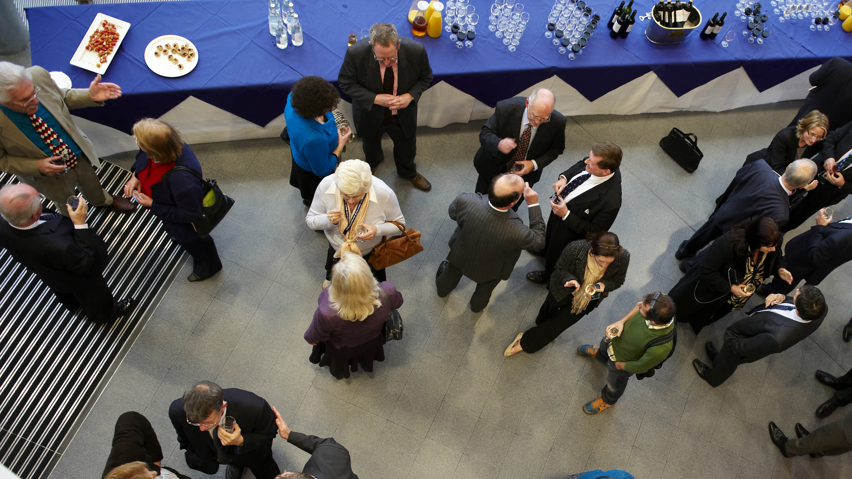 Birds eye view of people networking in small groups