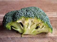 Green Broccoli Vegetable on Brown Wooden Table - Credit to http://homedust.com/