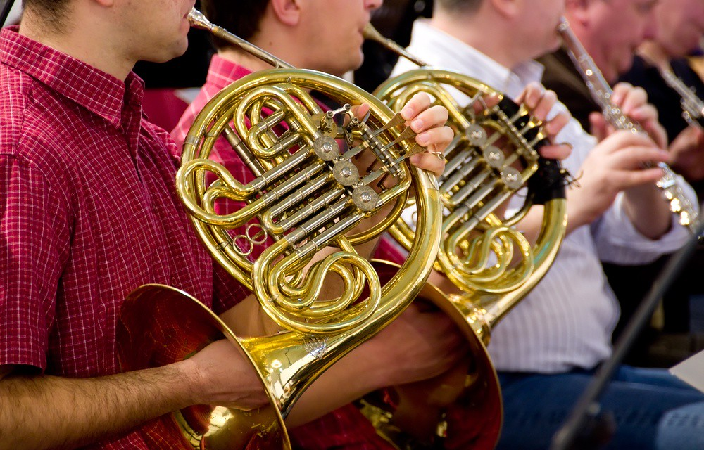 photo of brass and wind musicians rehearsing