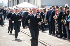 Sailors run to man USS Portland (LPD 27) during the ceremony. (U.S. Army/Staff Sgt. Zach Holden)