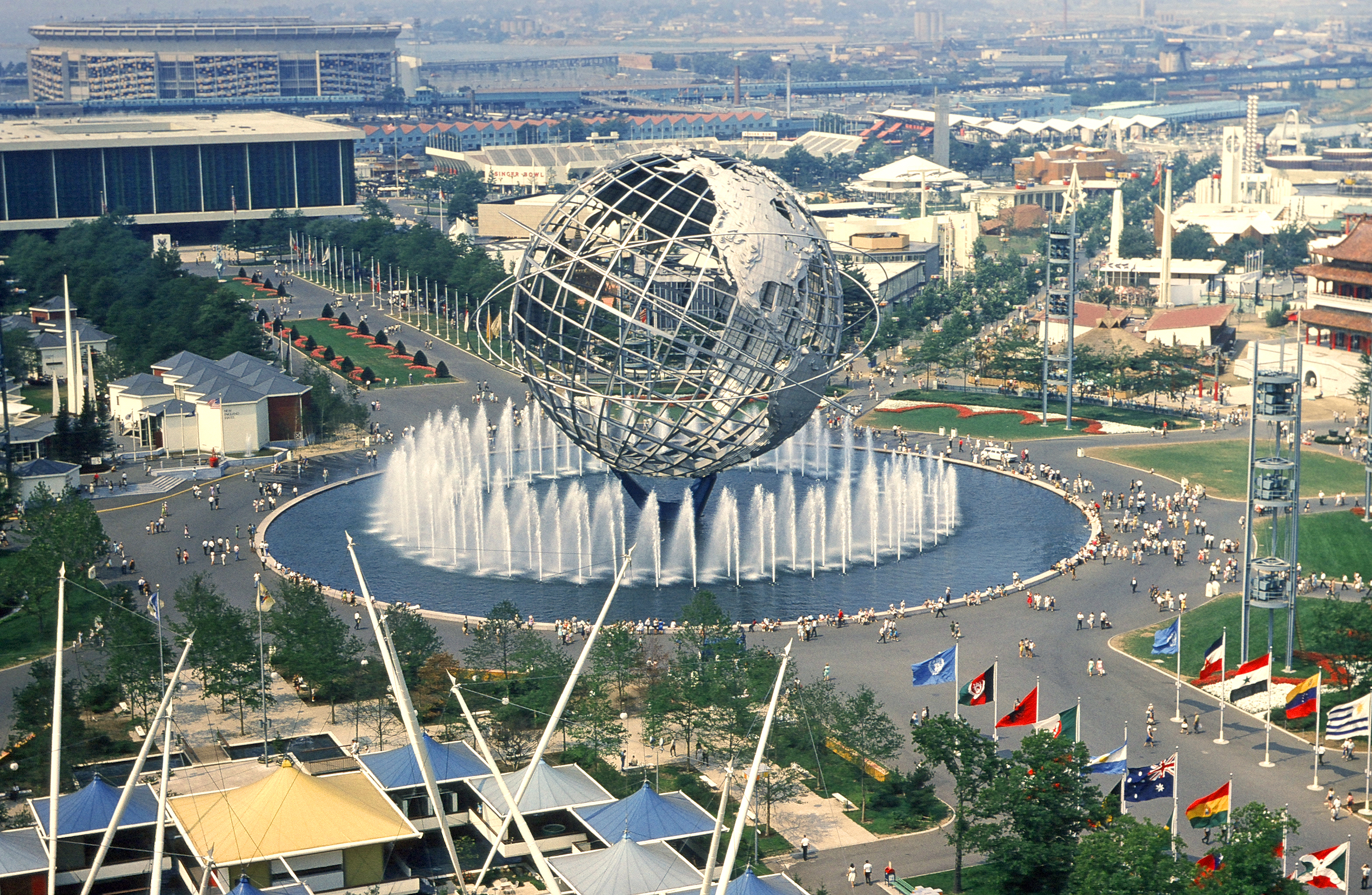 View from the observation towers of the New York State Pavilion; the Unisphere is in the center, Shea Stadium at far background left. Photo taken by Anthony Conti in August 1964.