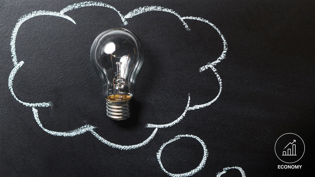 A lightbulb on a blackboard surrounded by a chalk thought bubble
