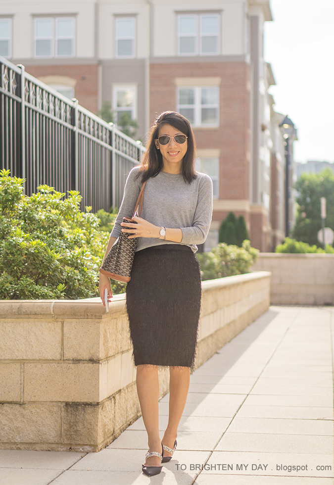 gray button back sweater, two tone watch, silver cuff, patterned tote, black fringe pencil skirt, black ballerina flats with jeweled straps