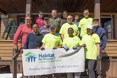 During a brief break, volunteers gathered for a photo on the front steps  a Habitat for Humanity build in Waterbury.