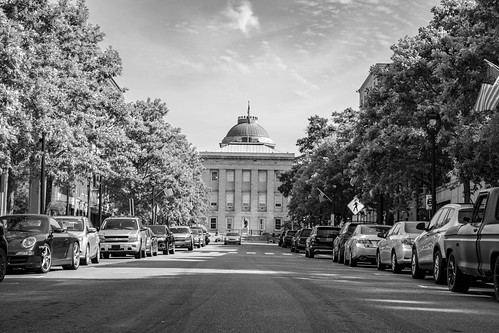 north carolina nc state capitol black white bw monochrome trees car street road clouds sky dome window building historic architecture