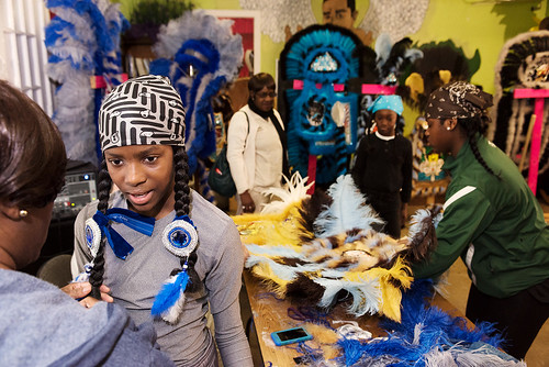 Wild Opelousas Big Chief Tycen gets help from his mother Takisha as the tribe prepares to show their suits their classmates and teachers on Febuary 8, 2017. Photo by rhrphoto.com.