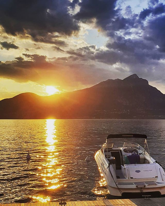 Sunset at the Lake #sunset #garda #gardasee #lake #sun #lights #wondeful #awesome #beautiful #photooftheday #picoftheday #igers #igersitalia #instagood #instago #italy #landscape #life #blue #sky #clouds