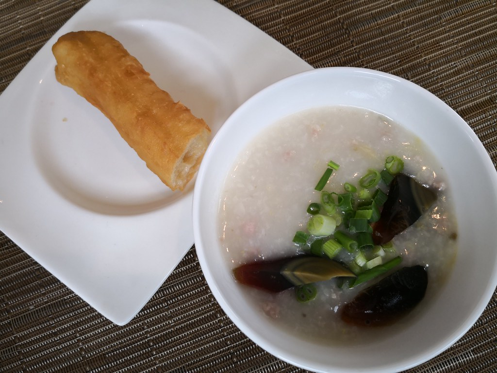 Century egg porridge and dough fritters