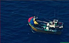 A missing fishing vessel floats in the Indian Ocean after being located by a U.S. Navy P-8A Poseidon maritime patrol aircraft, July 10. The P8-A from Patrol Squadron (VP) 45 joined the search effort at the request of the Sri Lankan Navy. The P-8A is the world's newest, most capable maritime patrol and reconnaissance aircraft and operates regularly throughout the Indo-Pacific in support of regional security and stability. (U.S. Navy photo)