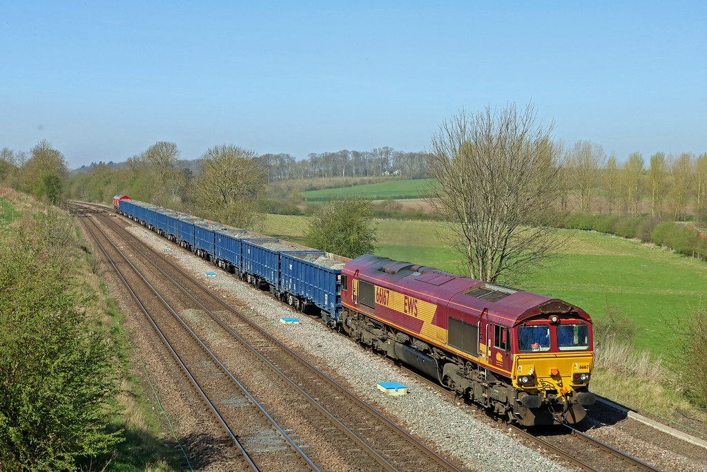 66167 tnt 66230 passes Melton Ross on 19.4.18 with 6E53 0844 Kellingley Colliery - Killingholme loaded blue JNA wagons with mud for Humber Estuary