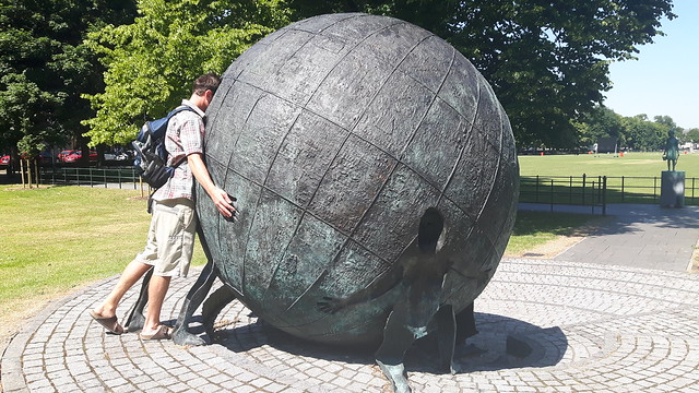 Looking into a large metal statue of a globe in Armagh, Northern Ireland.