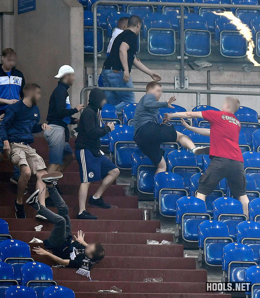 Schalke and Eintracht Frankfurt hools clash at the end of their DFB Pokal semi-final