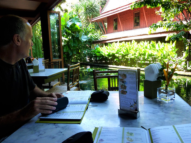 A Antipodean tourist taking in the sights at a cafe at Jim Thompsons, in Bangkok, Thailand