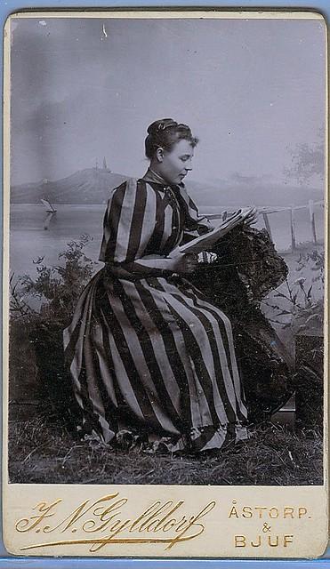 Woman reads cdv