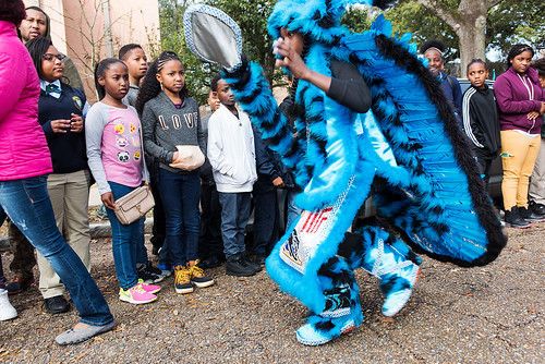 Wild Opelousas Flag Boy Tory Butler shows his suit to classmates after months of work on Febuary 8, 2017. Photo by rhrphoto.com.