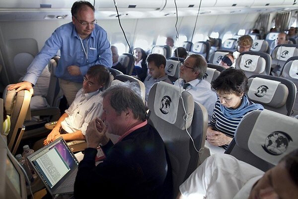 Մերկելին տեղափոխող ինքնաթիռի՝ լրագրողների հատվածը, Լուսանկարը՝ dpa