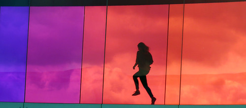 Girl skipping at the Rainbow Walk at the Aarhus ARoS Museum of Modern Art, Denmark