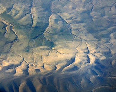 Aerial shot of a desert looking much like a Georgia O'Keefe painting