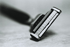 iron(0.0), lighting(0.0), shaving & grooming(1.0), monochrome photography(1.0), razor(1.0), close-up(1.0), black-and-white(1.0),
