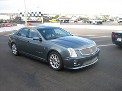 cadillac cts-v(0.0), cadillac xlr-v(0.0), automobile(1.0), automotive exterior(1.0), executive car(1.0), cadillac sts-v(1.0), cadillac(1.0), wheel(1.0), vehicle(1.0), full-size car(1.0), cadillac sts(1.0), cadillac cts(1.0), bumper(1.0), sedan(1.0), land vehicle(1.0), luxury vehicle(1.0),
