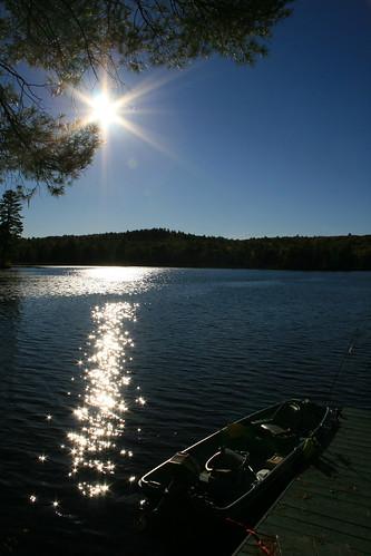 sunset sun water boat fishing