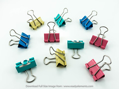 A Lot of Colorful / Multi Color Binder Clips Isolate On a White Background