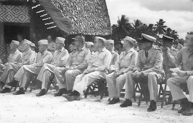The High Command assembled on Guadalcanal in August 1943, during the planning for the Northern Solomons campaign, this group includes many officers who played important roles in the operations to come. In the front row, left to right, are: Brigadier General A. F. Howard, Rear Admiral Theodore Wilkinson, USN, Major General Charles D..Barrett, and Major General Robert S. Beightler, USA
