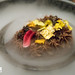 Chocolate covered fig leaf, chocolate ganache, edible gold leaf, edible flower petals set in dry ice