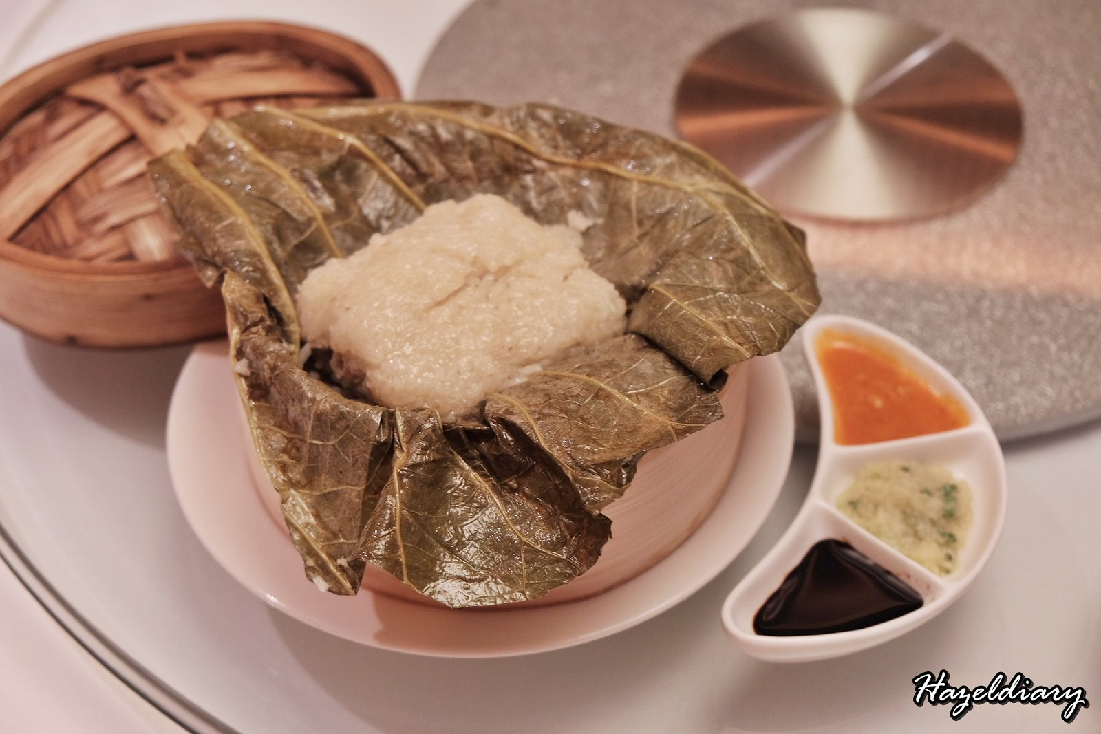 Yan Cantonese Cuisine-Steamed Hainanese Chicken with Sticky Rice wrapped in Lotus Leaf