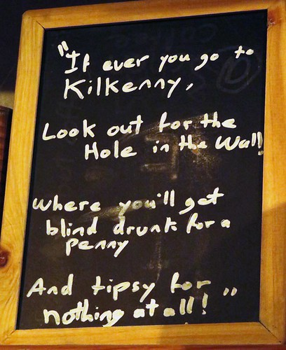 Hole-in-the-Wall Pub saying on a chalkboard in the pub of the same name in Kilkenny, Ireland