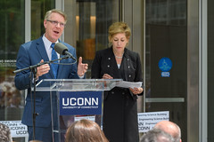 State Rep. Tim Ackert speaks at the dedication of the Engineering & Science Building on June 11, 2018.  At Right is President Susan Herbst. (Peter Morenus/UConn Photo)